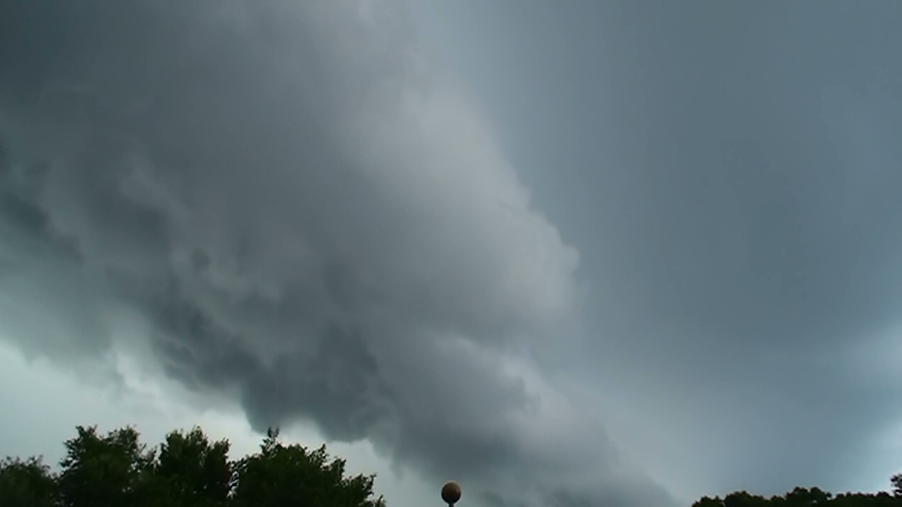 Thunderstorm wall approaches West Island Tower